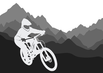Printed kitchen splashbacks Silhouette of a racer descending on a bicycle on a mountainside