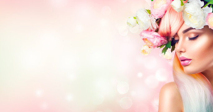Spring woman blooming flowers wreath on her head. Flowers hairstyle