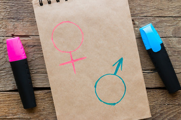 gender symbols drawn with colored markers