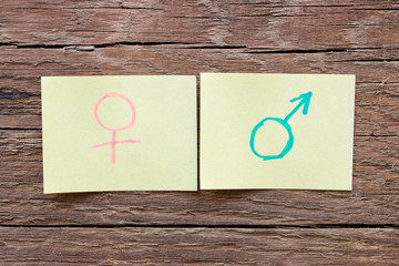 paper notes with the male and female gender symbols closeup