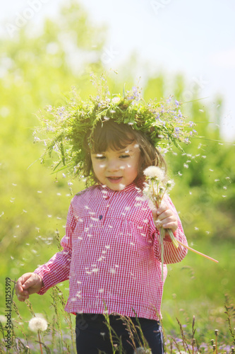 Girl with flowers in the spring outside. Selective focus.