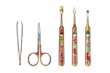 Beautiful colorful manicure set with scissors, forceps and sticks, with ornaments, isolated on a white background