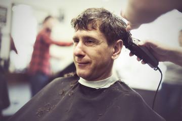 Smiling man in a barbershop