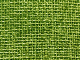 Green color hessian sack texture.