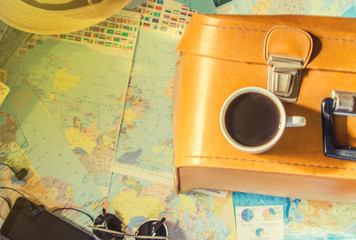 Background the journey, the reflection in the Cup of coffee. Map. Selective focus.