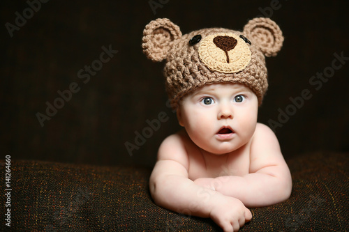 1a6d56560 cute surprised baby with an open mouth and a hat