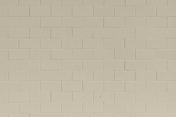 Clean, freshly painted, tan, generic, brick cinder block wall background.