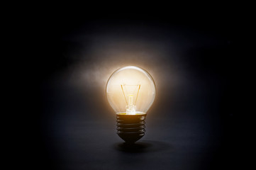 Glowing light bulb in dark.creativity inspiration concept