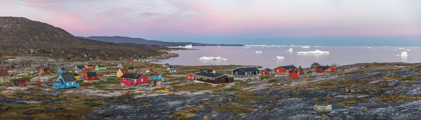 Panoramic views of Disko Bay with icebergs from the village Quaatsut summer night. The source of these icebergs is the Jakobshavn glacier, Greenland