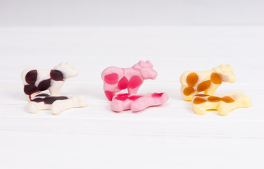 Candies in the form of a multicolored gummy cows