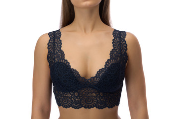 Lace bra tanned woman's body