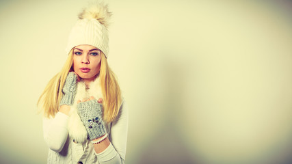 Attractive woman wearing winter clothes.