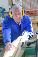 portrait of happy senior carpenter