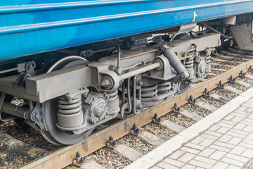 The wheels of a passenger train on rails