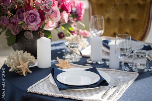Table setting at a luxury wedding or another catered event. Marine themes & Table setting at a luxury wedding or another catered event. Marine ...