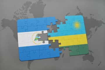 puzzle with the national flag of nicaragua and rwanda on a world map
