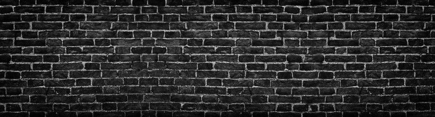 black brick wall, wide panorama as a backdrop