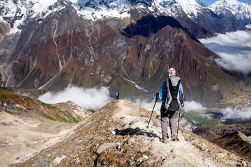 Trekker on the way to the valley covered with cloud on Manaslu circuit trek in Nepal