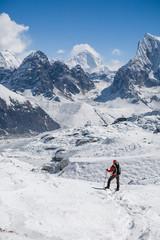 Trekker is walking by Renjo La pass in Everest region
