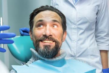 Man at the dentist smiling. Cheerful face of adult male. The happy customer.