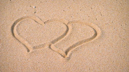 Two Hearts in the Sand on the Beach