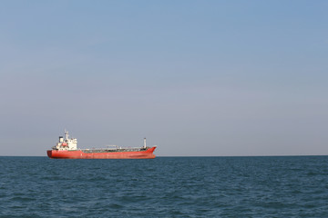 Marine cargo ship in sea.