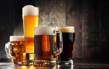 Self adhesive Wall Murals Beer / Cider Four glassed of beer on wooden background