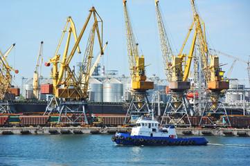 Tugboat and port cargo crane