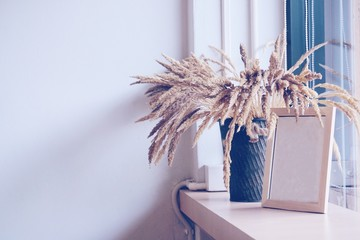 Dried flowers in the basket for decoration with frame in minimal style.