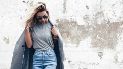 Model posing in plain tshirt against street wall Wall mural