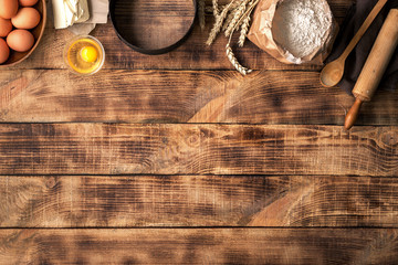 Wall Mural - Baking ingredients on a wooden table with copy space
