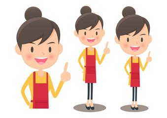 人差し指を立てるエプロン姿のアジア人女性