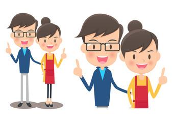 人差し指を立てるアジア人のカップル