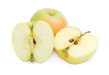 One whole and two halves of the green-pink apples