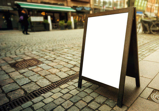 Blank restaurant advertising board as copy space on the street