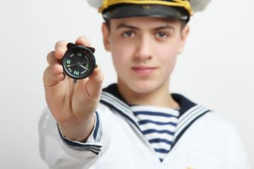 sailor holds a compass