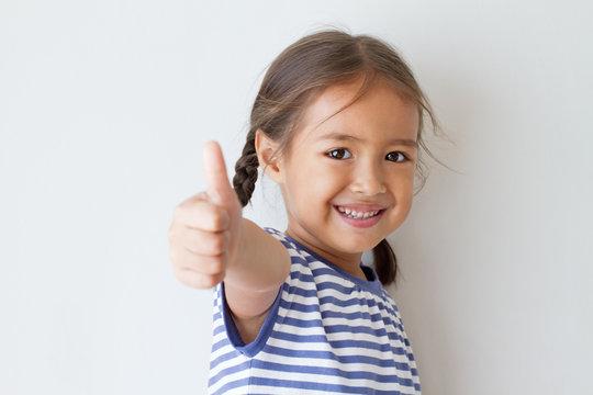 girl giving thumb up hand sign