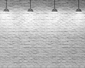 Brick wall and four ceiling lamps