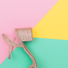 trendy concept of heel and sandals. shining gold and pop art colors.