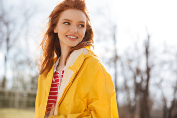 Portrait of a pretty happy girl in coat enjoying