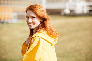 Portrait of a friendly pretty ginger hair girl in coat