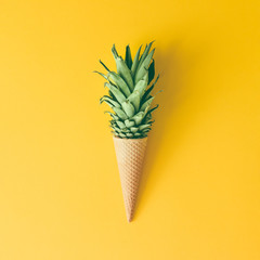 Ice cream cone with pineapple leaves