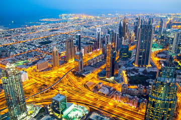 Top view of a highway junction and the coast in Dubai, UAE, at sunrise. Sheikh Zayed road in Dubai downtown.