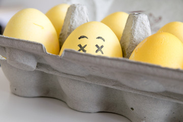Happy easter: hidden face emoji as easter egg in a box - close-up