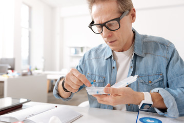 Self-confident man choosing blue tablet