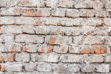 Red cement brick wall texture with mortar background close