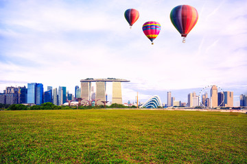 Colorful hot-air balloons flying over the park at singapore