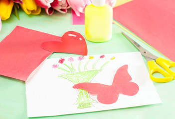 Homemade card with butterfly on wooden background