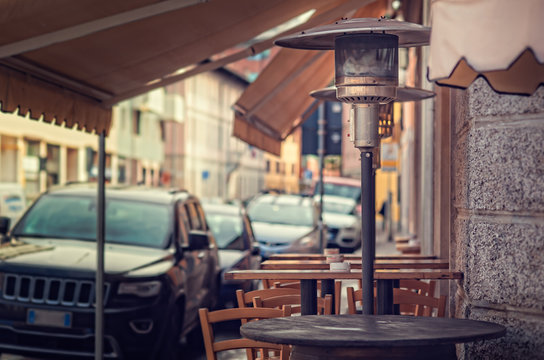 Gas heater, patio heater, mushroom heater. Tables for eating outdoors.