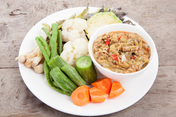 pimp chili paste or Chili paste Thai style with steamed and fresh vegetables